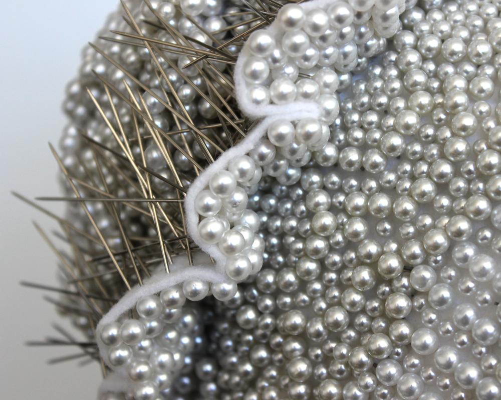 "Seer Bonnet: Elizabeth (Age 16) (detail) 17,131 pearl corsage pins, fabric, steel, 61"" x 9.5"" x 12"", 2012-2013"