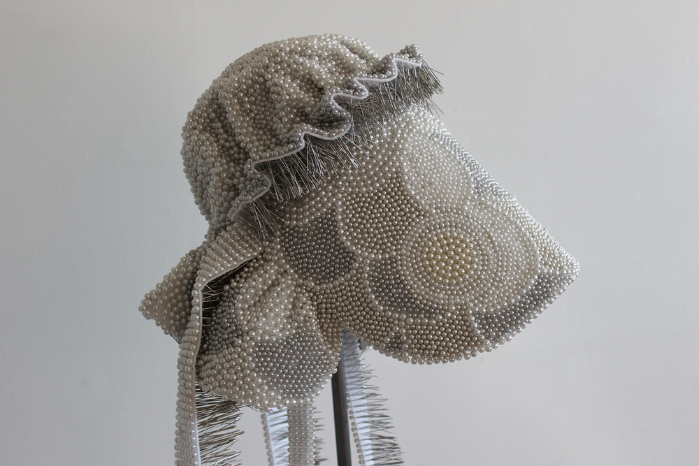 "Seer Bonnet XX (Emily Partridge)  19,306 pearl corsage pins, fabric, steel, wood, 53"" x 13"" x 16"", 2011"