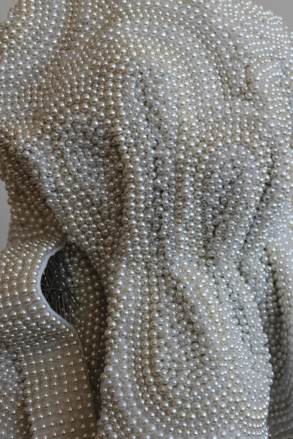 "Seer Bonnet XVIII (Ruth)  (detail) 31,863 pearl corsage pins, fabric, steel, wood, 65"" x 12"" x 15"", 2011"