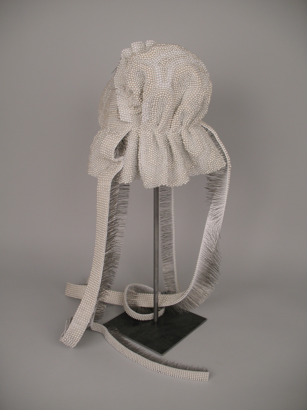 "Seer Bonnet XVI (detail) 16,194 pearl corsage pins, fabric, steel, 29"" x 12.5"" x 13.5"", 2010-2011"