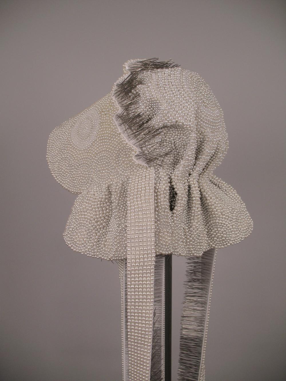 "Seer Bonnet XV  19, 712 pearl corsage pins, fabric, steel, 69"" x 12"" x 16"", 2010-2011"