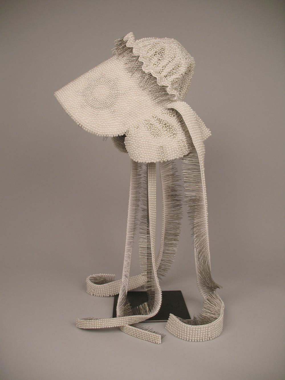 "Seer Bonnet XIV (Delcena)   14,760 pearl corsage pins, fabric, steel, 29"" x 12"" x 14"", 2010"