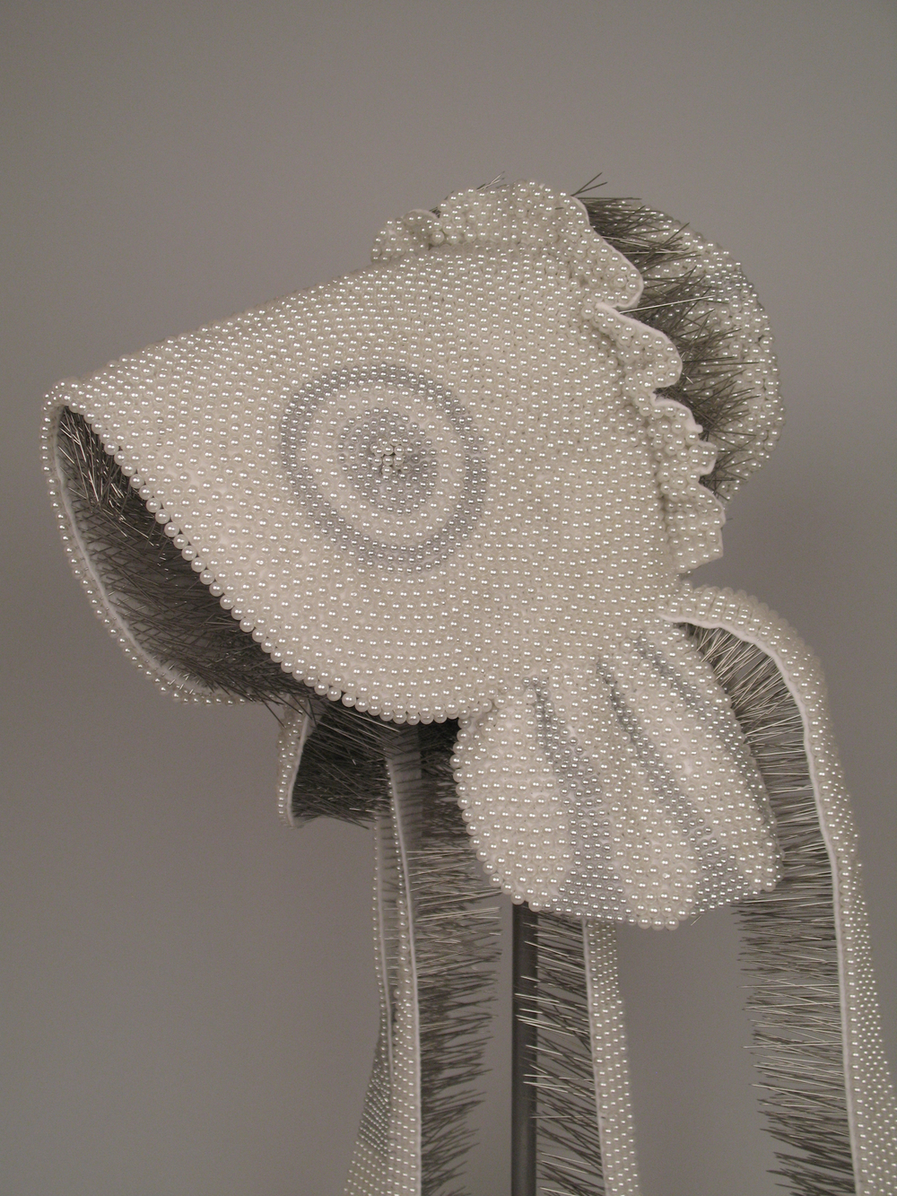 "Seer Bonnet XII  4,609 pearl corsage pins, fabric, steel, 54"" x 12"" x 15"", 2010"