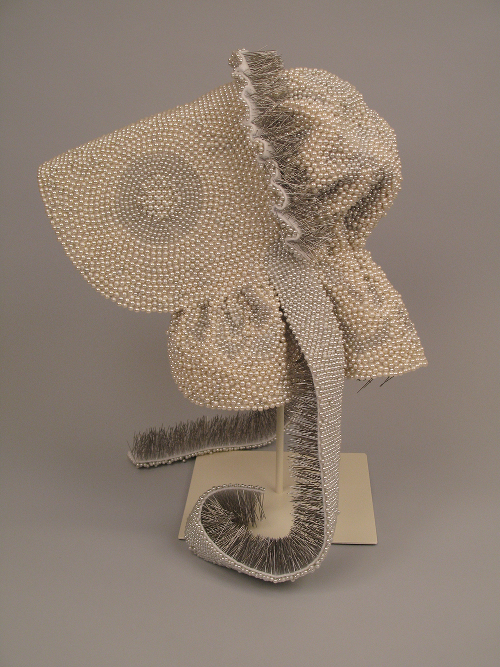 "Seer Bonnet V  14,544 pearl corsage pins, fabric, 19"" x 11"" x 13"", 2009"