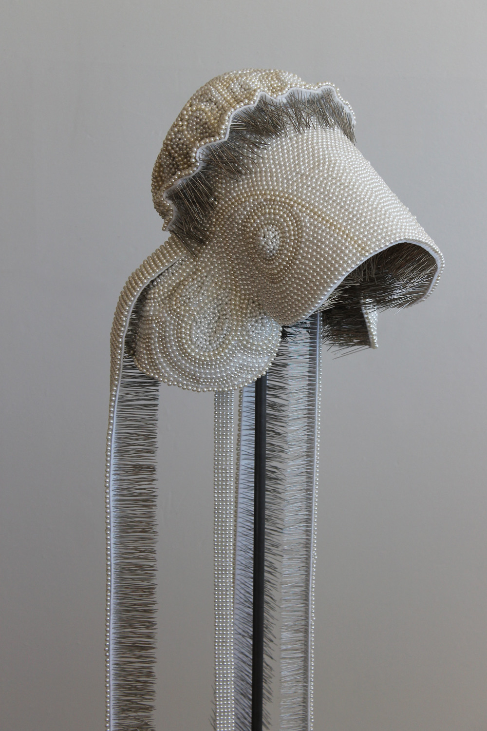 "Seer Bonnet XVIII (Ruth)  31,863 pearl corsage pins, fabric, steel, wood, 65"" x 12"" x 15"", 2011"
