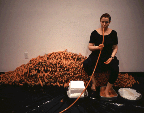 Her/She Senses: Caffeine and Carotene   Angela Ellsworth and Tina Takemoto  Harnett Gallery, Rochester, New York Icehouse, Phoenix, Arizona  A three-day performance featuring over nine hundred pounds of carrots, a juicer attached to an exercise bicycle, coffee, and yards of clear medical tubing. For four hours each day, Ellsworth and Takemoto perform various labor-intensive tasks related to alternative cancer treatment, health spa fitness, juice bars, and coffee culture through a spectacle that appears both exhausting and absurd.
