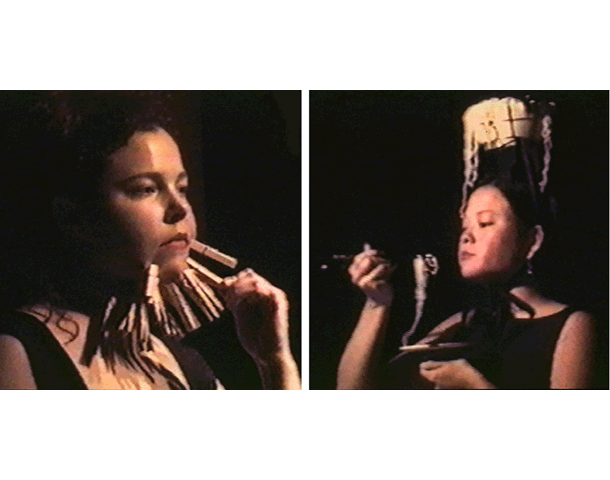 Her/She Senses: Learning How   Angela Ellsworth and Tina Takemoto  Black Box, New Brunswick, New Jersey     In this performance, Ellsworth clips dozens of clothespins to the flesh on her face while Takemoto eats Top Ramen noodles out of a clay pot on her head.