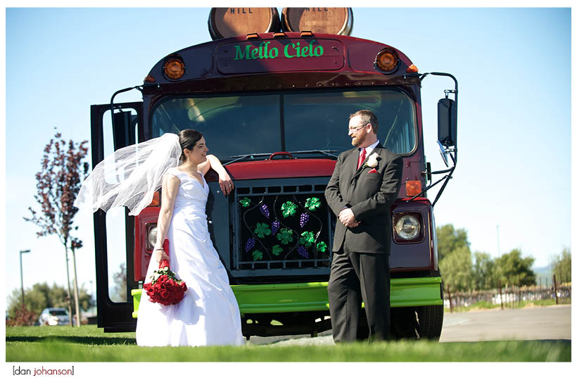 bride and groom front of winery bus
