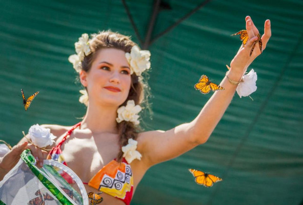 A woman releases butterflies at last year's Earth Day celebration in San Francisco. Photo courtesy of Earth Day San Francisco.