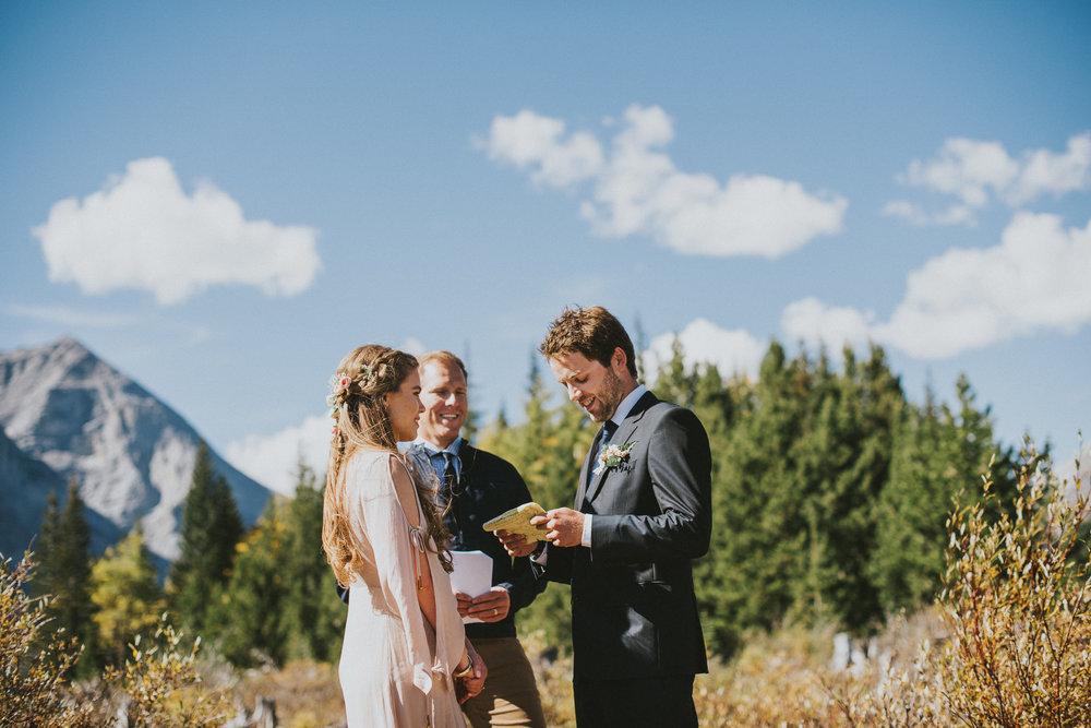 kananaskis elopement couple groom exchanging vows