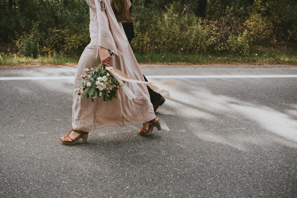 elopement bride walking bouquet candid kananaskis