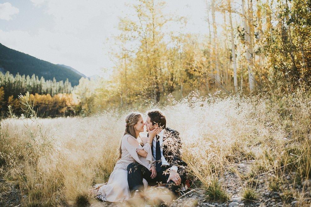 bride groom kiss field elopement portrait kananaskis