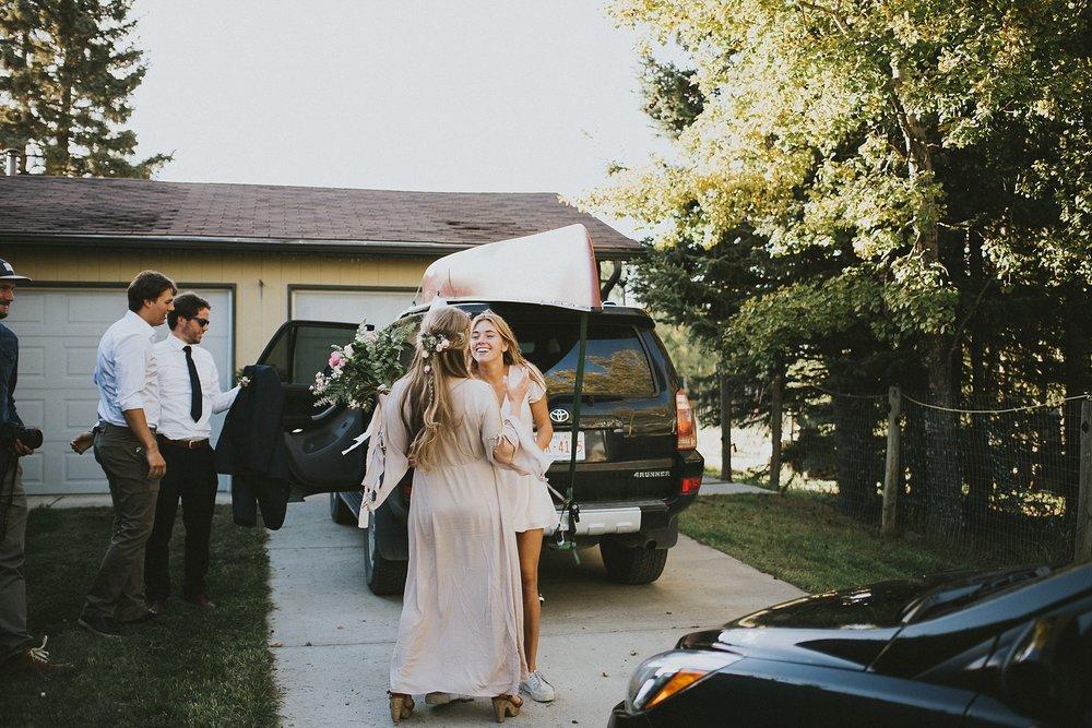 bride friend candid kananaskis elopement