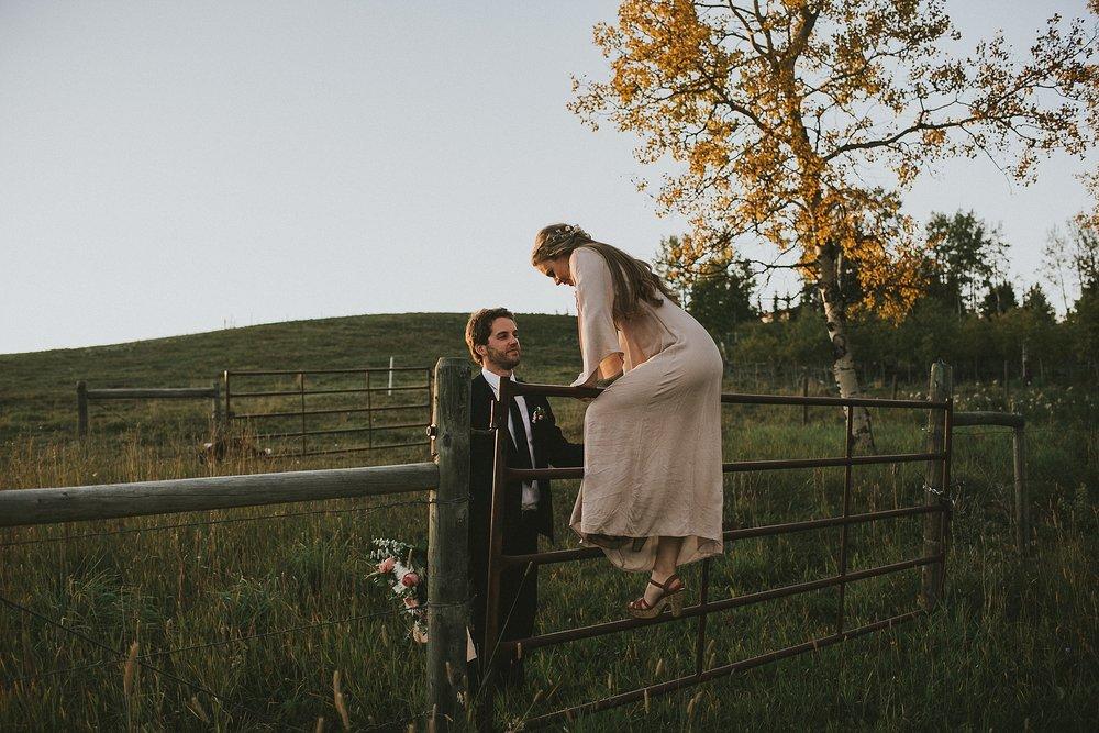 bride groom fence sunset portrait kananaskis elopement