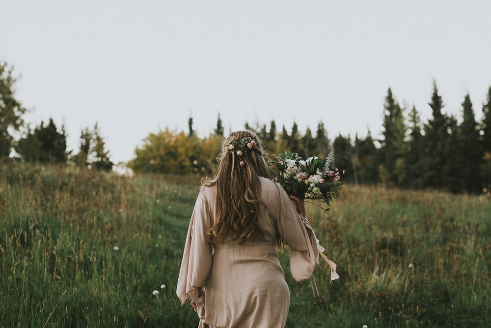 bride candid hair flowers bouquet kananaskis elopement