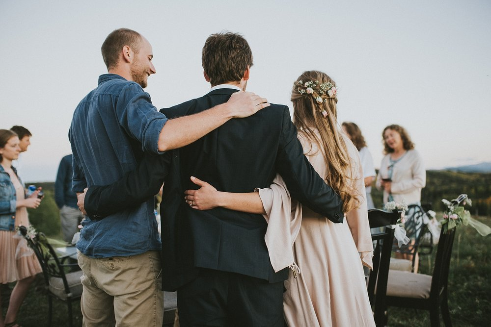 bride groom guest hug reception kananaskis elopement