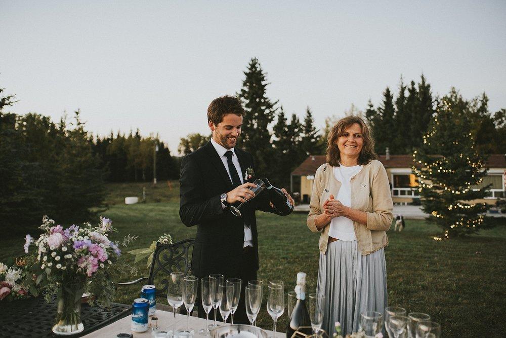 groom champagne candid reception kananaskis elopement