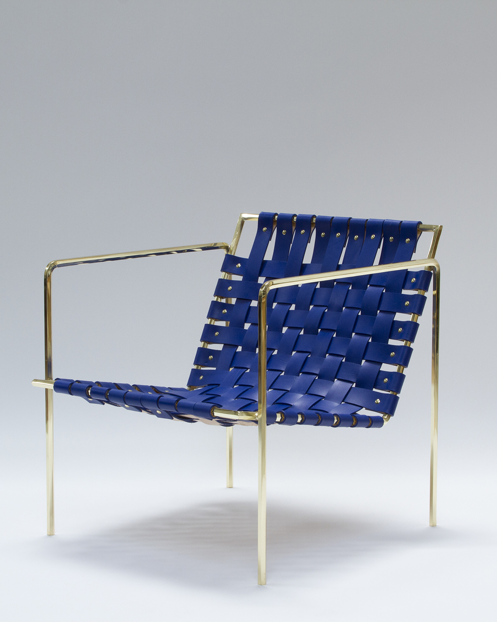 Rod+Weave chair with Brass Frame and Blue leather.
