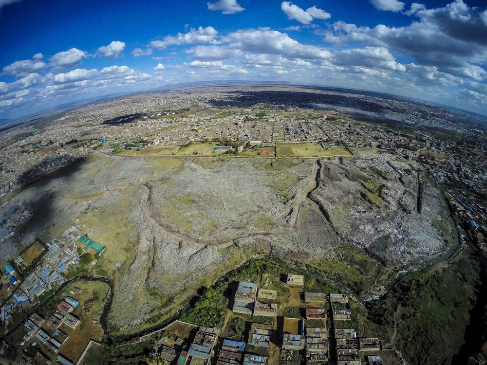 "This former quarry is now one of the largest dumpsites in Africa at 30 acres. It opened 40 years ago by City Council as a temporary solution for waste management - it was declared full in 2001. After plans to move the site to Ruai fell through in January 2016, Governor Evans Kidero decided to expand its capacity for 10 more years of operation. This move is also said to be ""temporary."""