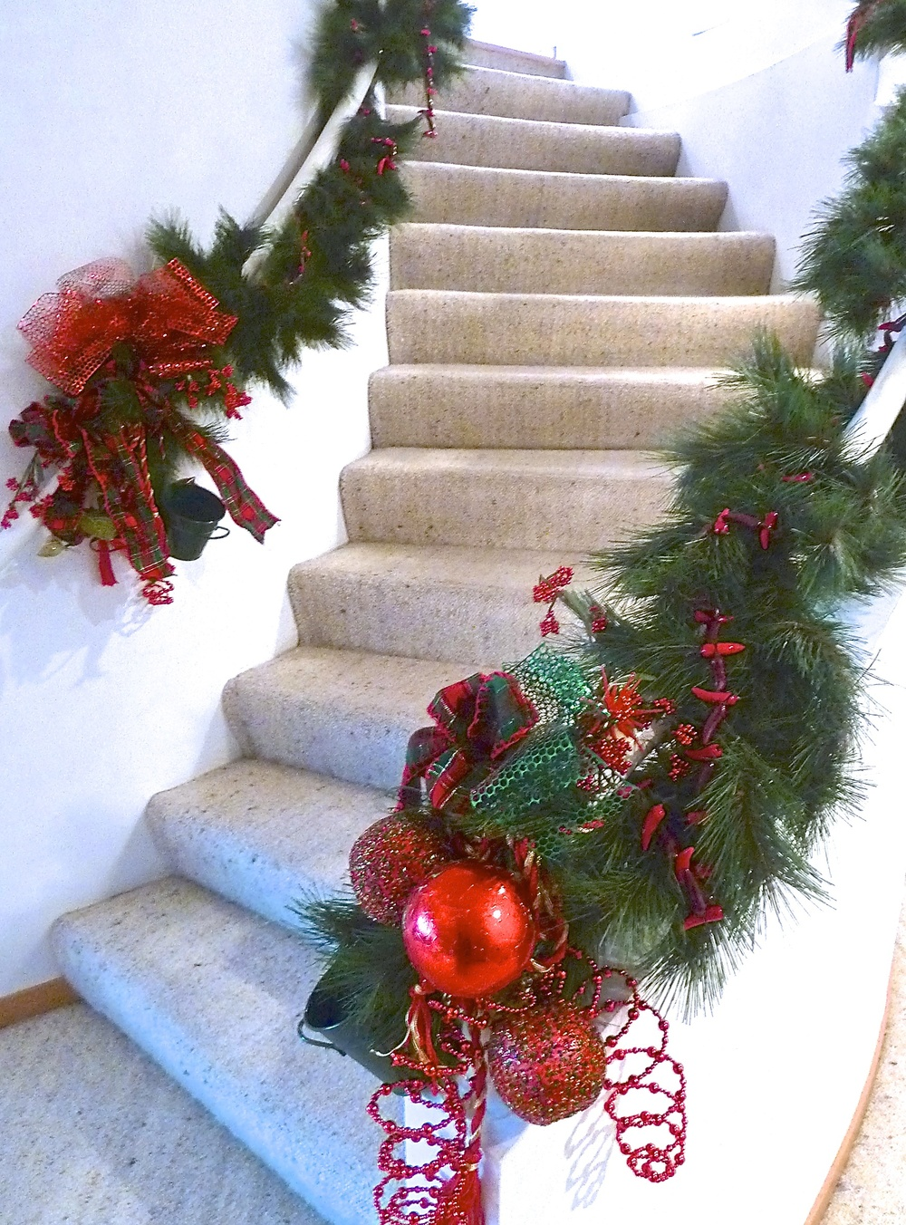 Artificial Christmas boughs can still add spice to the banisters...