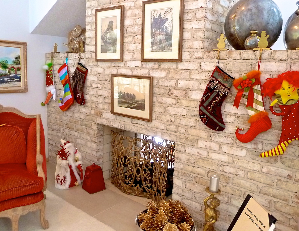 Stockings combined with fire pots, fireplaces, pine cones and of course SANTA!