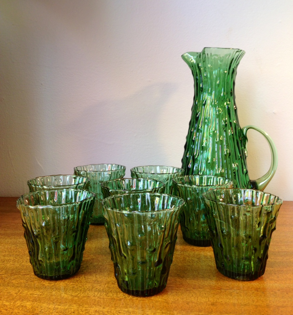 "MidModMen believes these are Morgantown ""crinkle"" glasses and pitcher. Definitely vintage! And we have lots of other juice-sized glasses in stock..  https://www.facebook.com/MidModMen"