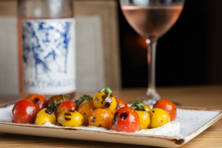 Blistered Heirloom Tomatoes, Ricotta, Sea Salt, Mint, and Chili Oil paired with Matthaisson Rosé Blend, Napa, 2014 -  photo by  Caroline Hatchett -