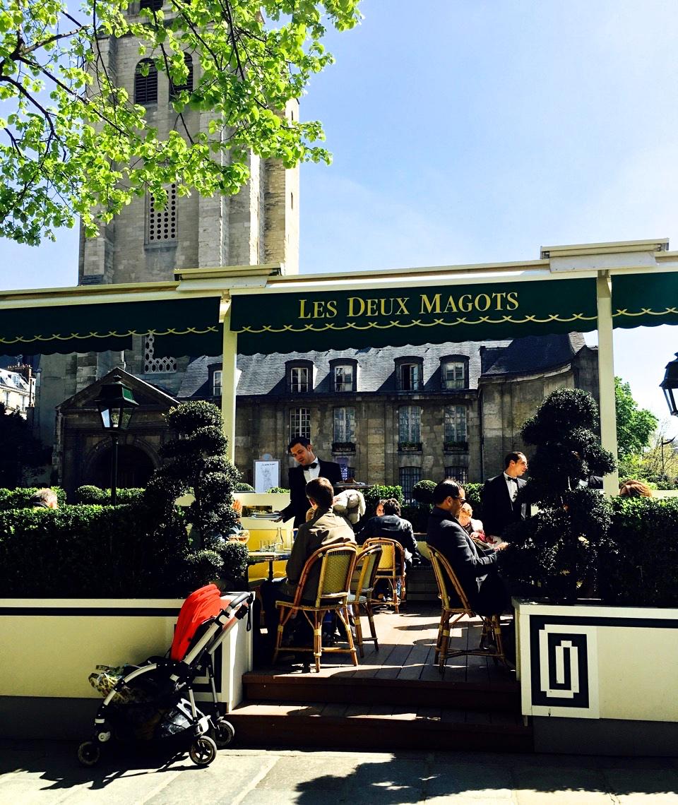 The Terrace of   Café Les Deux Magots  with a view of Saint-Germain-des-Près in the background (photo by Lisa Michaux)
