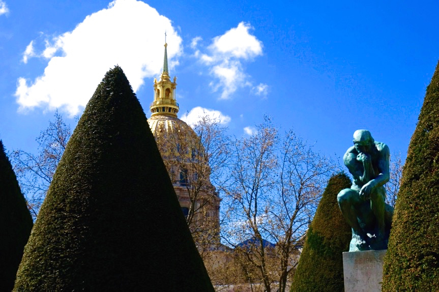 April in Paris: Auguste Rodin's  Thinker  and the Dome of the Invalides (photo courtesy of Lisa Michaux)