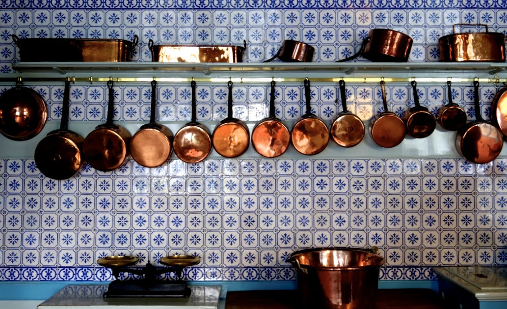 Monet's Blue and White Kitchen with Copper Pans   (photo courtesy of Lisa Michaux)