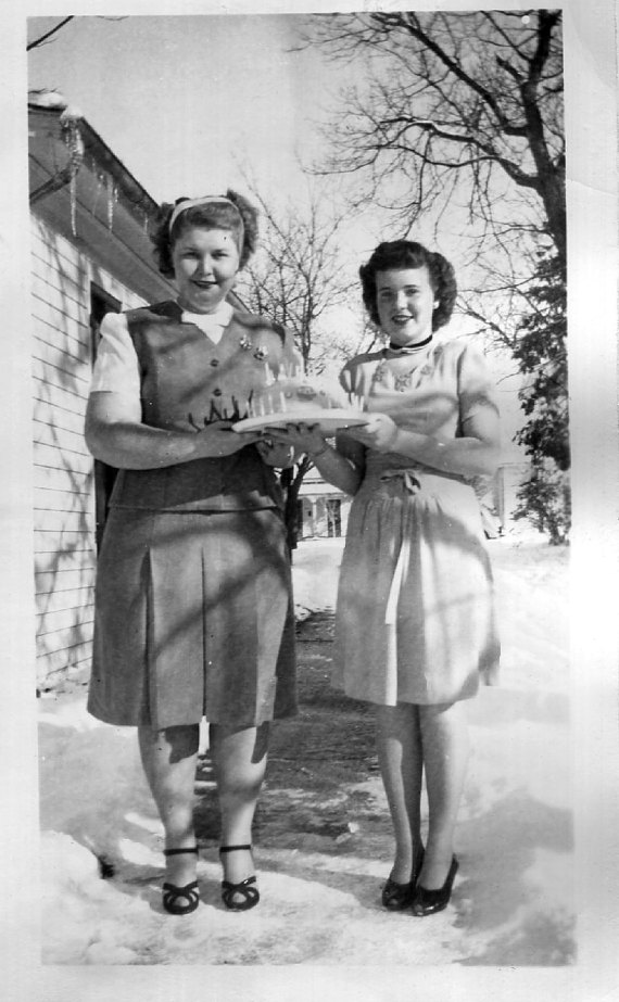 1940s-vintage-image-of-2-women-celebrating-a-birthday-in-the-winter.jpg