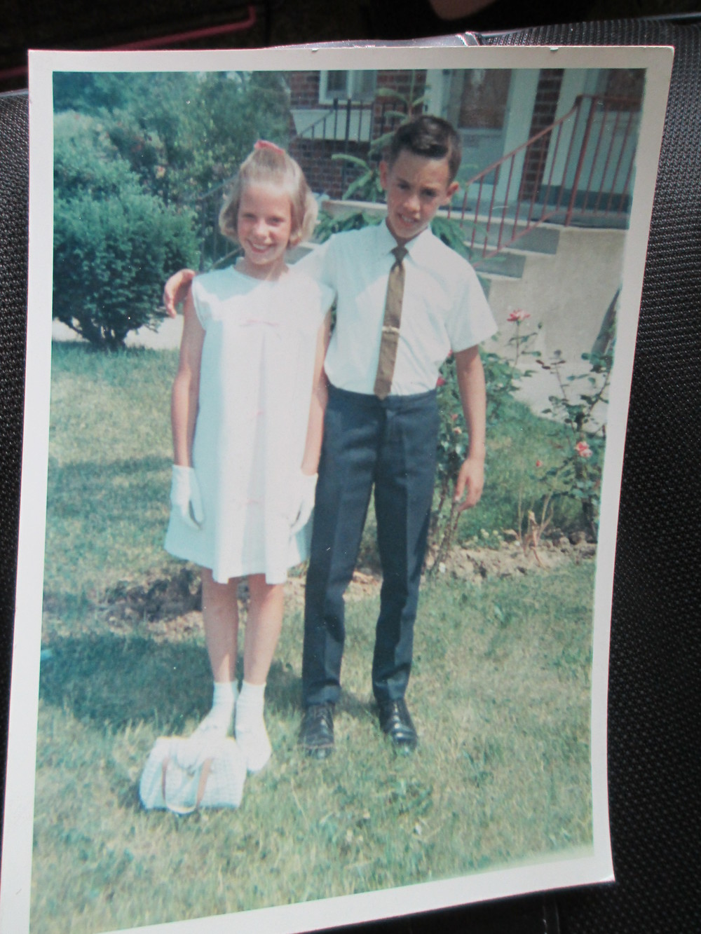 In our Easter outfits, check out those gloves and my groovy handbag!