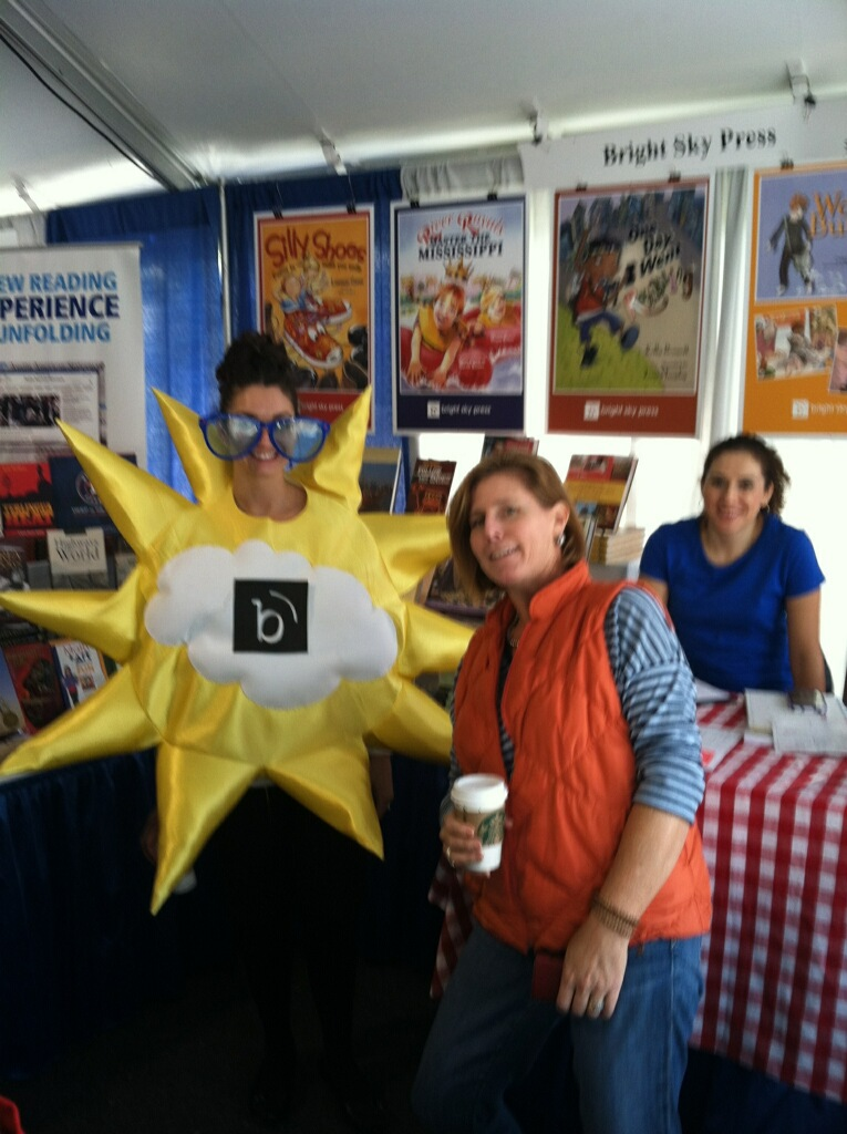 """Sunny"" Eva, Lucy Chambers, & Marla, hosting the Bright Sky Press booth."