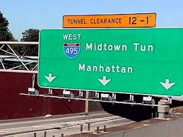 I glimpsed a sign for the Mid-town Tunnel as I zoomed past . . .