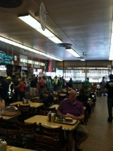 "Sat at Meg Ryan's infamous "" Sleepless in Seattle "" table at  Katz's Deli (with the bossiest, grouchiest staff in the world!)"
