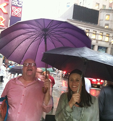 Hunkered under a nut vendor's umbrella during a rain shower, then finally broke down--after we were soaked--and bought umbrellas.