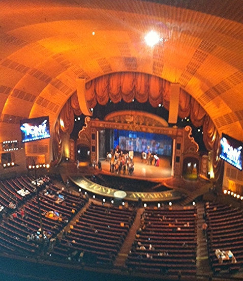 "Toured Radio City Music Hall--and sneaked snaps of Tony Award rehearsal through the camera room window. Then, come Sunday night, glued ourselves to the TV with take-away dinner to watch the show because ""we were there""!"