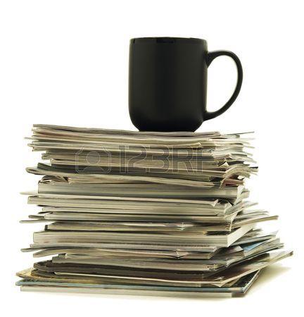 6786281-black-mug-sitting-on-top-of-a-stack-of-magazines.jpg