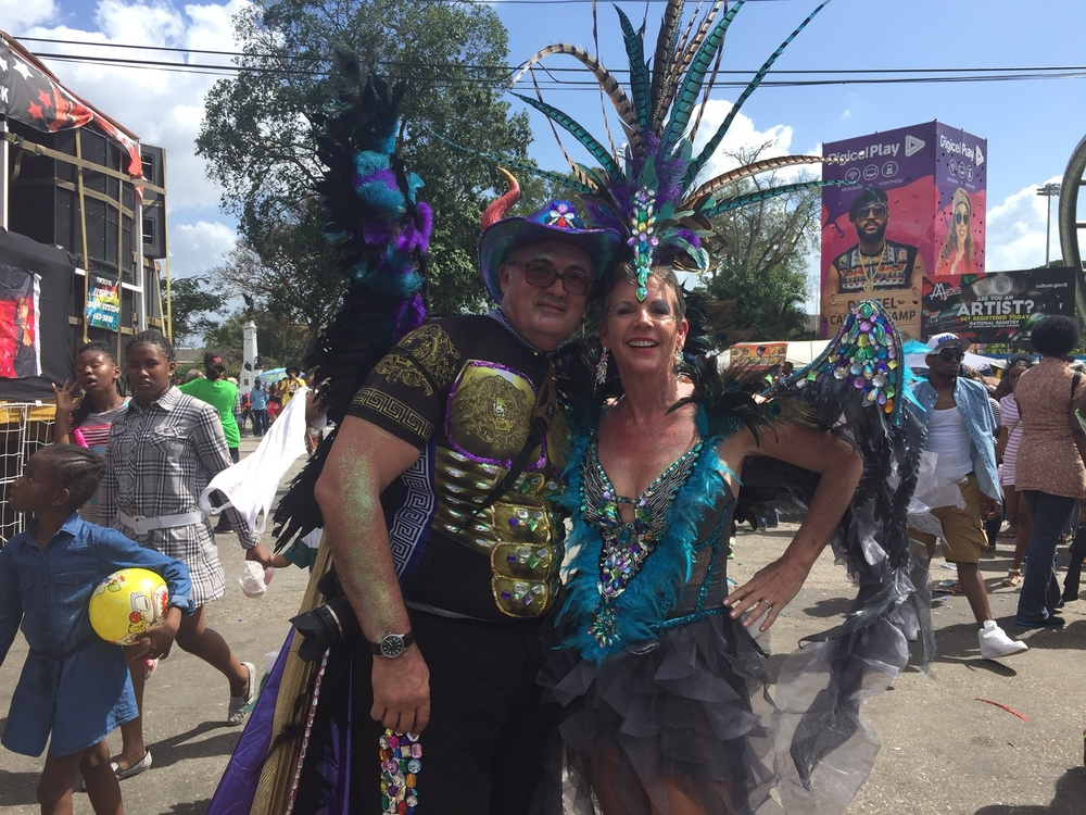 Yes, Curtis and I (with help from friends) glued all those beads, feathers and bling onto our Trini Devil & Angel costumes.