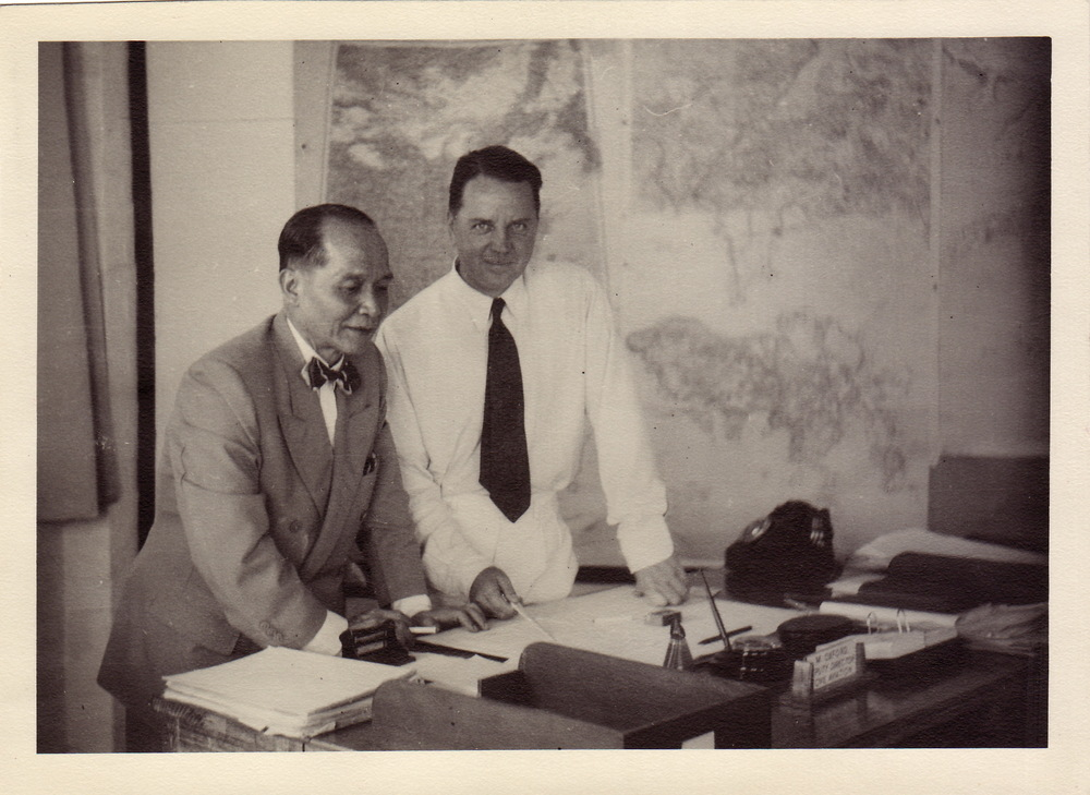 Admiral Chan visiting Max's office in the Department of Civil Aviation