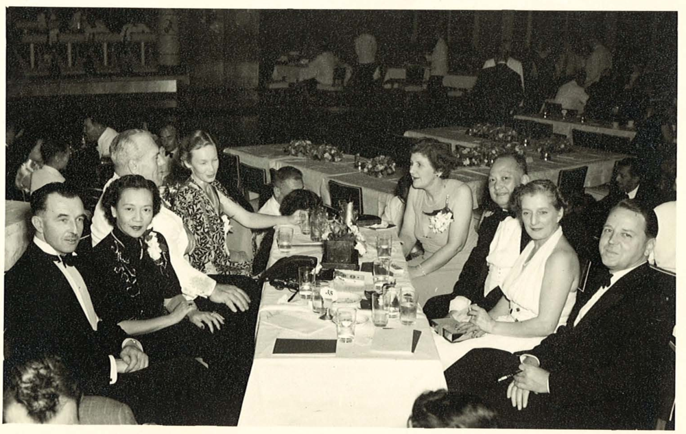 Max (front right) and Audrey (back left) have dinner with friends at Luna Park, 1950