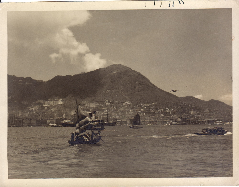 Planes, junks and ferries traffic Hong Kong harbour, 1950