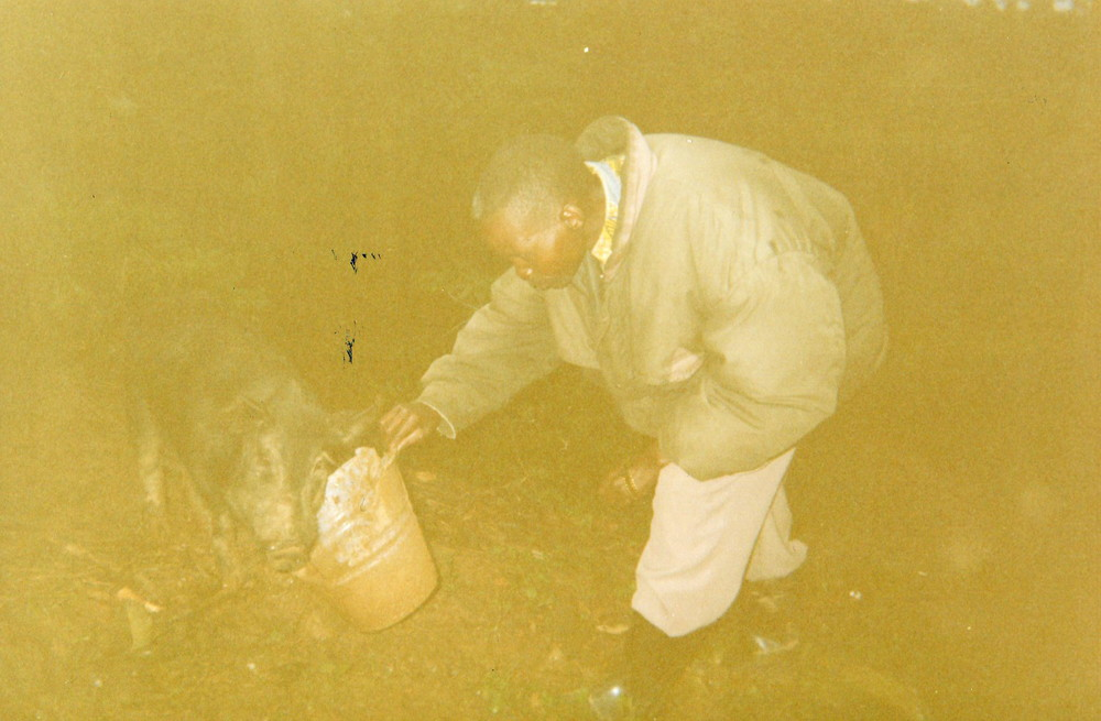A father who raises pigs to pay for his children's school fees.