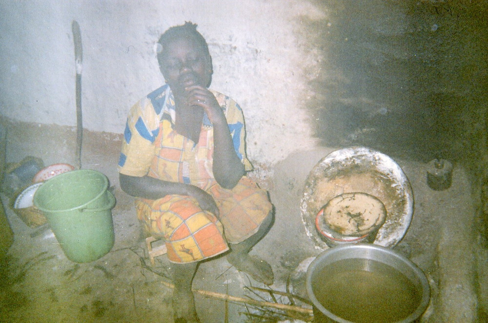 The kitchen represents the food in the house, but the person is worried because of its bad quality and the insecurity in the region.