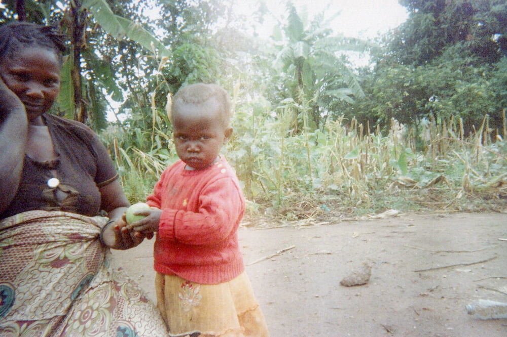 The woman here regrets to feed her child only with fruits, without other necessary food for his health.