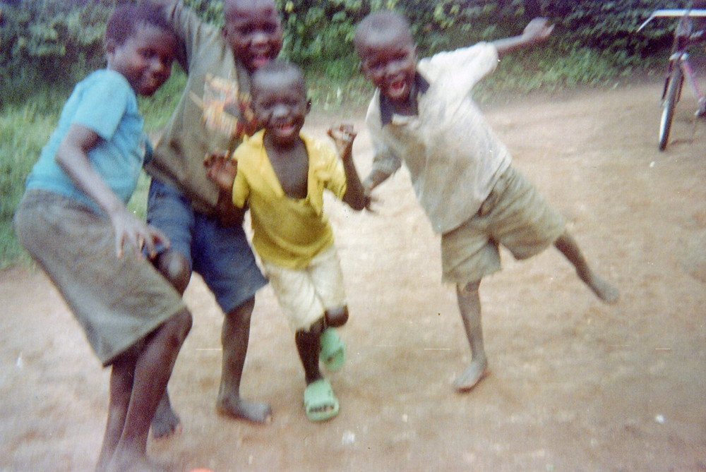 The children are happy to return to the village after the calm is instituted by MONUC in 2002.