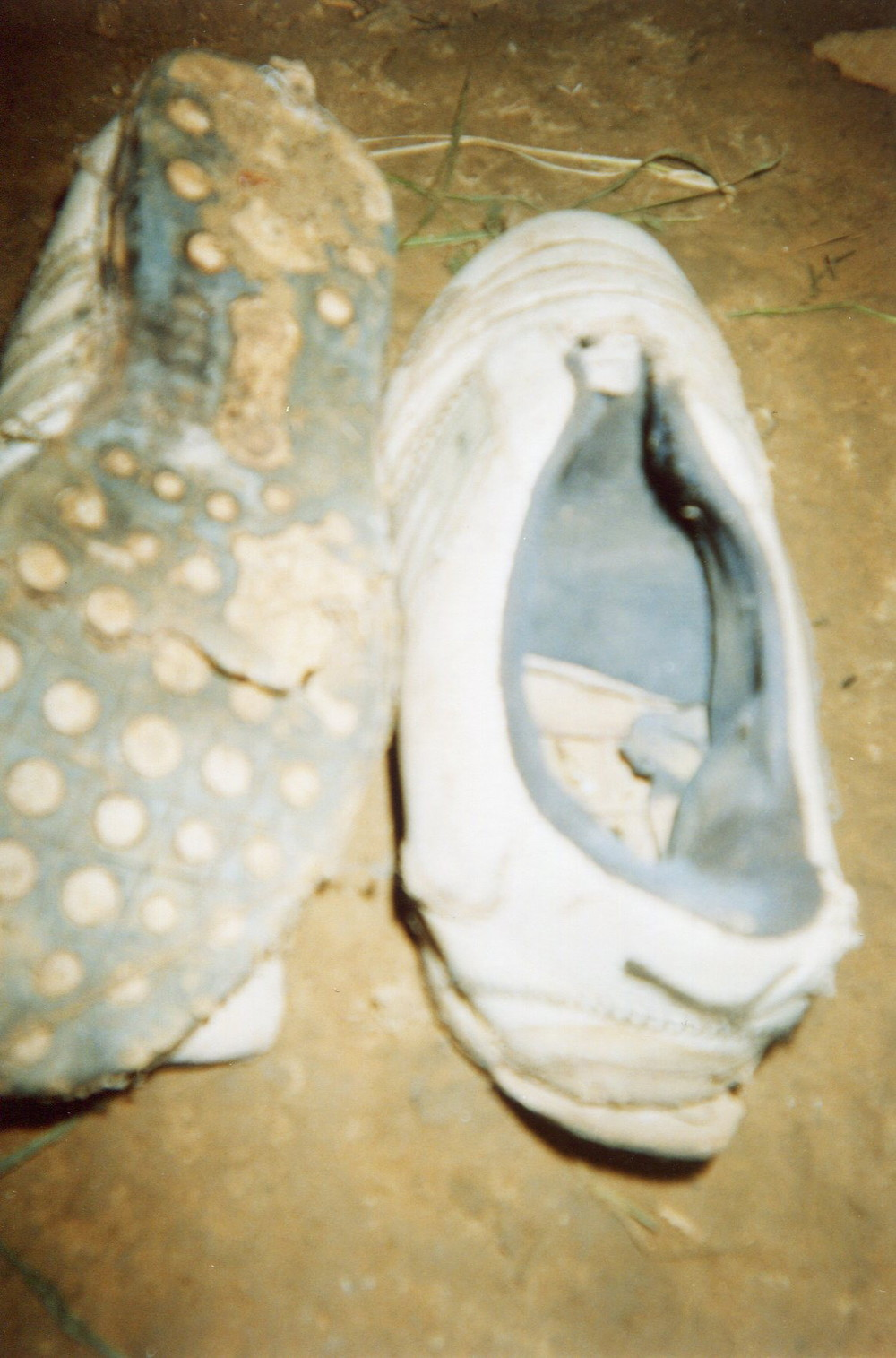 The shoes of a soldier are severely punctured.