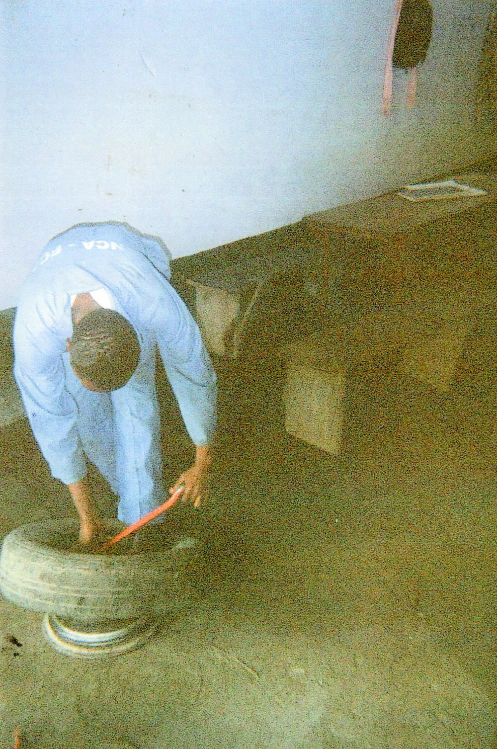 I am repairing a car tire.