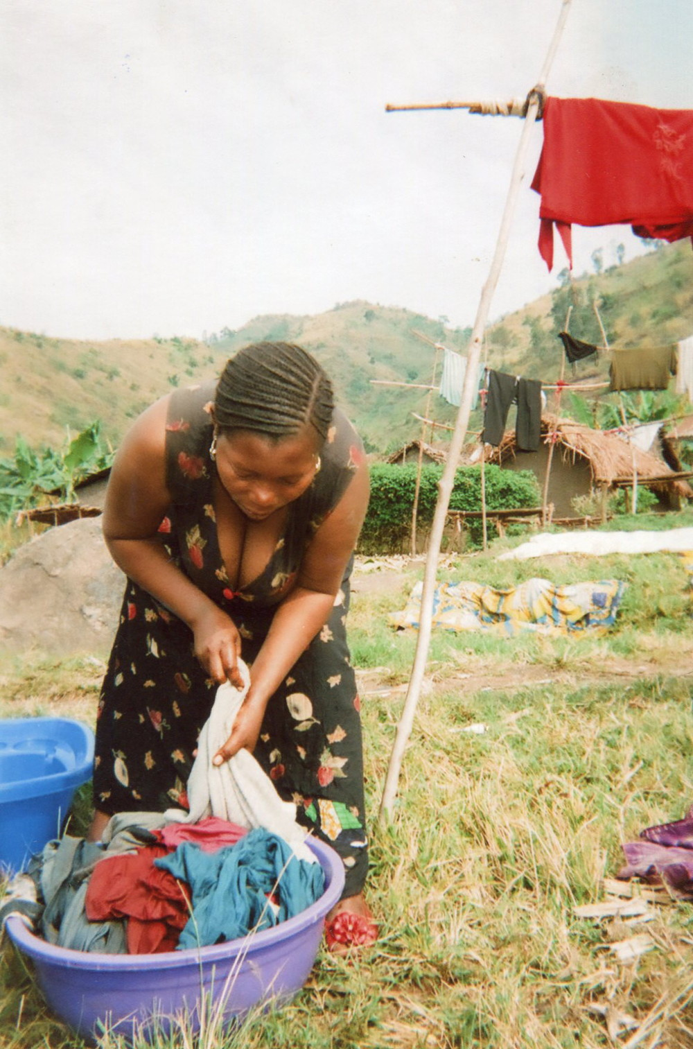 Here I am washing their clothes and they would make me do it quickly beating me with a stick.