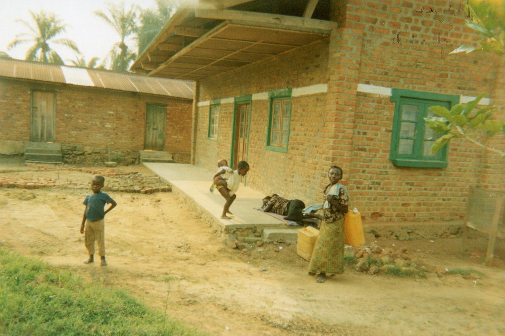 My children slowly start to get used to the village, here they are coming from fetching water.